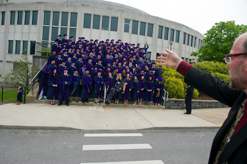 28331s0024xx  Graduates line up for their annual group photo taken before the College of Law Commencement outside the Creative Arts Center Saturday May 12, 2012.