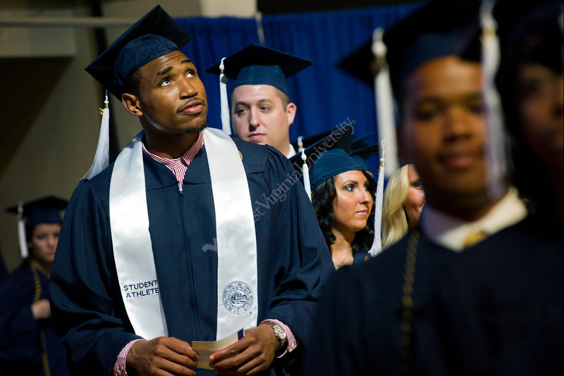 28343s0048xx  Kevin Jones an MDS major of Mount Vernon, Ny looks at the scoreboard during the Eberly Commencement in the Coliseum Sunday May 13, 2012.