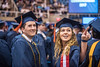 Brandon Butrik, a Mining major graduating Magna Cum Laude and Rachel Boothby also a Mining major point towards family and friends at The Statler College of Engineering Commencement at the Coliseum May 13th, 2017.  Photo Brian Persinger