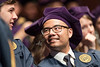 WVU College of Law graduate shares a smile at the College of Law commencement May 12, 2017. Photo Greg Ellis