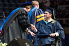 WVU CHES graduate Jeremy Rearick  is awarded his Master's degree in Clinical Rehabilitation and Mental Health Counseling by dean Gypsy M. Denzien  at the WVU College of Education and Human Services commencement. May 13, 2017 at the WVU Coliseum. Photo Greg Ellis