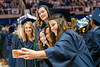 WVU graduate Mary Elizabeth Shelby Elementary Education major make a selfie with fellow graduates at the WVU College of Education and Human Services commencement. May 13, 2017 at the WVU Coliseum. Photo Greg Ellis