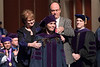 WVU College of Law graduate Anna Castro is hooded by her parents Carol and Tom Casto at the College of Law  Commencement. Photo Greg Ellis