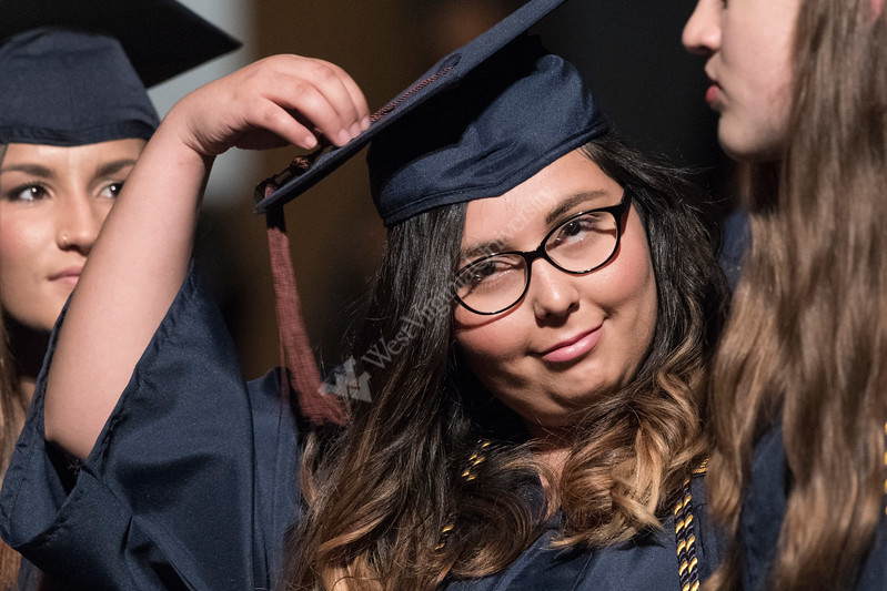 A graduate of the CAC adjusts her mortar board May 12; 2017 prior to receiving her degree. Photo Greg Ellis