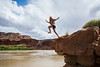 Kaitlyn Gregg jumps into the Green River in the Canyonlands National Park backcountry May 15, 2017.