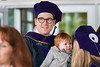 WVU College of Law graduate Josh Miller holds his child Ari Miller following his commencement May 12, 2017.
