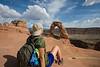 Kaitlyn Gregg takes a break from hiking to look at the famed Delicate Arch in Arches National Park near Moab, Utah May 8, 2017.