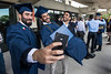 Mohammad Almarhon, a Mechanical Engineering graduate, Yousiff Alabdalhadi, a Mechanical Engineering graduate and Husain Alshawaf pose for a selfie following The Statler College of Engineering Commencement at the Coliseum May 13th, 2017.  Photo Brian Persinger