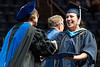 WVU CHES graduate Leah Devine Instructional Design and Technology  receives her diploma from dean Gypsy M. Denzien  at the WVU College of Education and Human Services commencement. May 13, 2017 at the WVU Coliseum. Photo Greg Ellis