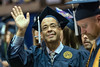 WVU Regents graduate John Cuff waves to the audience at the WVU College of Education and Human Services commencement. May 13, 2017 at the WVU Coliseum. Cuff started his degree at WVU in 1981 finishing in 2017. Photo Greg Ellis