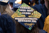 WVU graduates share their thoughts and dreams atop their mortar boards at the Reed Media College commencement, May 12, 2017. Photo Greg Ellis