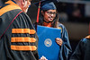 Swathi Shetty, a Mechanical Engineering graduate poses with Dean Gene Cilento for a photograph at The Statler College of Engineering  Commencement at the Coliseum May 13th, 2017.  Photo Brian Persinger