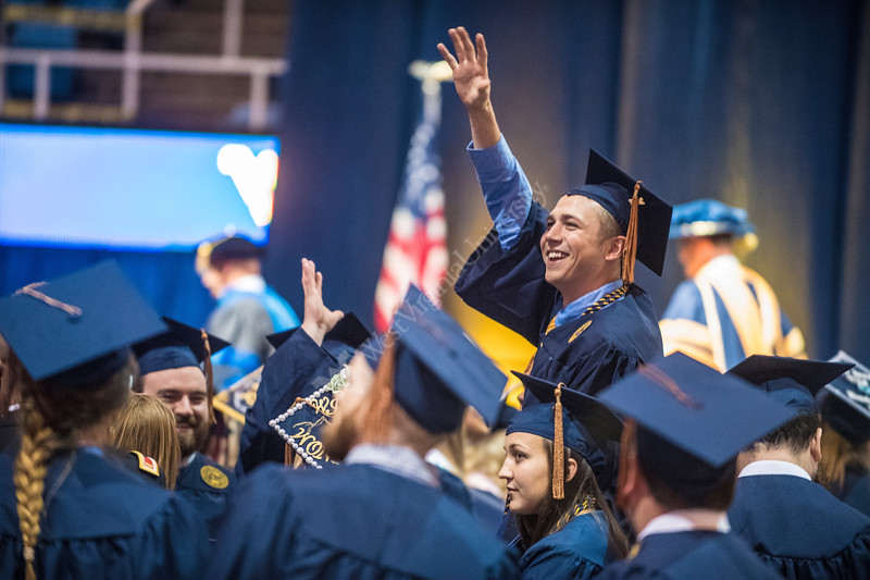 Jack Tasker a Foresty major waves to his family at The Davis College of Agriculture, Natural Resources and Design Commencement in the Coliseum on May 12, 2017. Photo Brian Persinger