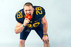 WVU student athletes encourage healthy eating habits as part of the Family Nutrition Program, developed by the WVU Extension Service College. WVU football player fullback #28 Elijah Wellman endorses this eating a Sweet Red Pepper, May 5, 2017. Photo Greg Ellis