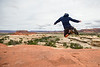 Caleb Kisamore clicks his heels while scrambling on the rocks of Canyonlands National Park in eastern Utah May 10, 2017