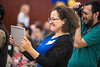 Claudia Esparza of Chile makes a video of her husband Juan Carrasco as he is recognized at the Global Affairs annual International Graduation at the Erickson Alumni Center May 11th, 2017.  Photo Brian Persinger