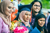 Fareesah Zul, a Petroleum Engineering graduate poses with friends and family for a picture after the Statler College of Engineering Commencement at the Coliseum May 13th, 2017.  Photo Brian Persinger