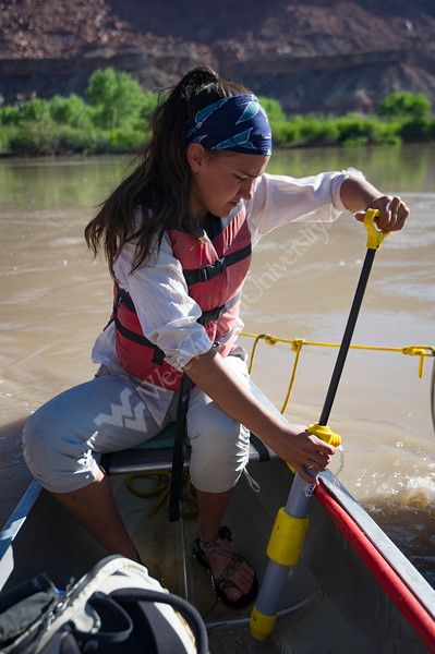 Katie Adase pumps water out of her canoe prior to launching for the 11 mile trip to the next campground in the Canyonlands National Park backcountry May 14, 2017.