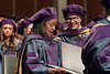 WVU College of Law graduate reviews her diploma during the WVU College of Law commencement May 12, 2017. Photo Greg Ellis