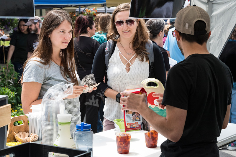 Faculty, students, staff and the public enjoy the WVU Medicine Farmer's Market held at the WVU Health Sciences center, May 5, 2017. Photo Greg Ellis.