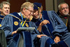 """WVU President E. Gordon Gee chats with William Harrison """"Bill"""" Withers Jr. May 12, 2017 at the CAC commencement. Withers was awarded a Doctor of Music, by the College of Creative Arts. Photo Greg Ellis"""
