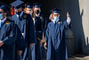 A graduate gives a thumbs up while entering Milan Puskar Stadium for Commencement, May 15, 2021. Photo: Geoff Coyle