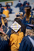 A WVU graduate wears a Friends-inspired cap during Commencement, May 15, 2021. Photo: Geoff Coyle.