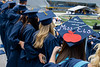 Students with well decorated caps sing country roads at the Spring 2021 commencement. May 16, 2021. Photo: Mark Webb.