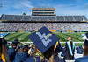 A student wears a Flying WV on a graduation cap while celebrating Commencement inside Milan Puskar Stadium, May 15, 2021. Photo: Geoff Coyle.