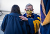 WVU President Gordon Gee embraces a graduate during Commencement, May 15, 2021. Photo: Geoff Coyle.