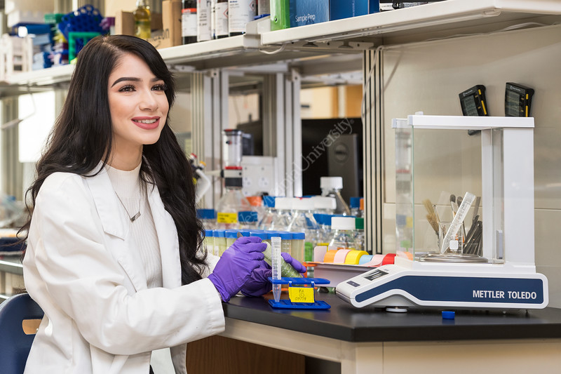 Marissa Frazie an undergraduate student at WVU's Davis college poses for an Environmental Portrait in her research lab November 30, 2017. Photo Greg Ellis
