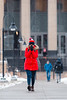 A student tries to warm up her cold hands while walking across the Evansdale campus.