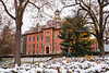 A student walk past Martin Hall on a snowy day.