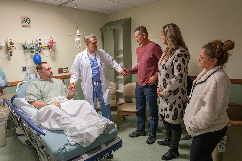 Jared Buckhalter DBS patient shares a moment with Dr Ali Rezai, MD and his parents Regina and Rex Buckhalter Pre-Op at J.W. Ruby Memorial / WVU Medicine Hospital November 1, 2019. (WVU Photo/Greg Ellis)