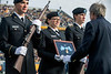 John Cuthbert of the West Virginia and Regional History Center presents the WVU Army ROTC Color Guard the Thomas W. Bennett Medal of Honor during a halftime recoginition at the WVU Texas Tech Football game at Mountaineer Field November 9th, 2019. (WVU Photo/Brian Persinger)