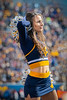 A WVU cheerleader cheers on the fans at the WVU Texas Tech Football game November 9, 2019. (WVU Photo/Greg Ellis)