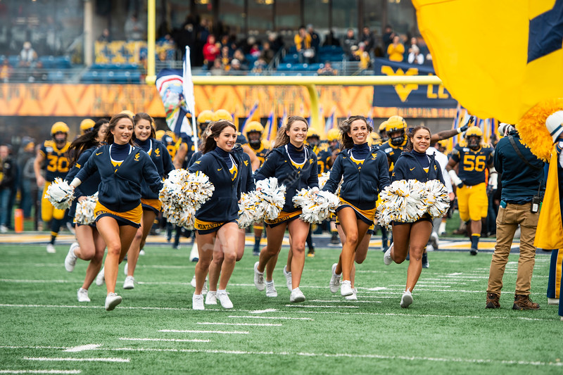 WVU Cheerleaders run onto the field. The Mountaineer Football team faced off against OSU at Mountaineer Field November 24, 2019. (WVU Photo/Parker Sheppard)