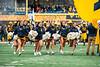 WVU Cheerleaders run onto the field. The Mountaineer Football team faced off against OSU at Mountaineer Field November 24, 2019. (WVU Photo/Parker Sheppard)