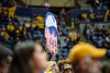 Fan holds a cut out of Neal Brown's face in the stands. WVU's basketball team took on Akron November 8, 2019. (WVU Photo/Parker Sheppard)