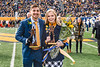 Students who have attained great achievements in their academic career and have put forth great effort in extracurricular activities compete for the title of Mr. and Ms. Mountaineer. The winners were Patrick Orsagos (L) and Caroline Leadmon (R), announced during the half-time show of the November 9th, 2019 football game at Milan Puskar Stadium.  (WVU Photo/Hunter Tankersley)