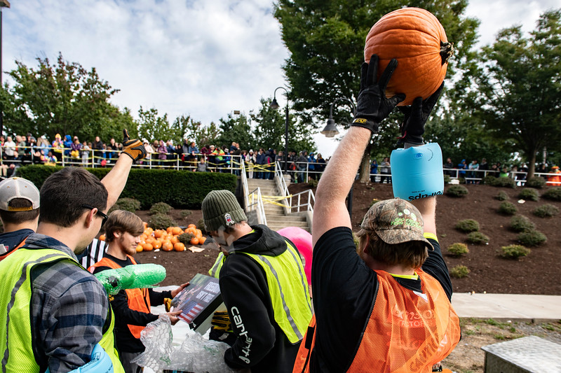 Mechanical Engineering major Benjamin Morris lifts a successfully dropped pumpkin belonging to West Fairmont Middle School during the 2018 Pumpkin Drop at the Engineering Sciences Building October 19th,2018.  Photo Brian Persinger