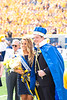 WVU Homecoming King and Queen, Kendra Lobban and Douglas Ernest Jr, greet the crowd after being crowned. WVU Football went head to head against Kansas on October 6th, 2018 at Milan Puskar Stadium. The game ended with a win for WVU, 38-22. Fans participated in the WVU Gold Rush event being held during this game, resulting in a crowd of golden people