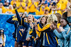 The Women's Soccer team is recognized on the field in between quarters as The Mountaineers play Eastern Carolina University in Morgantown, September 9th, 2017.  Photo Brian Persinger