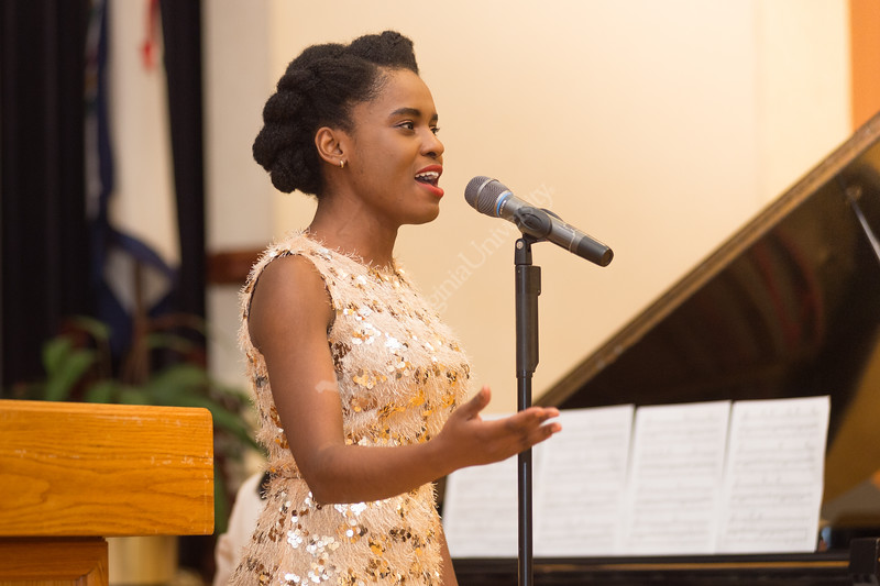 "Agatha Holland, Doctoral Student in Performance and 3rd year Fellow, sings ""The Impossible Dream"" from Man of La Mancha, Mitch Leigh. New and returning fellows came together at the Mountainlair Ballroom to be recognized for their achievements on September 5, 2019. (WVU Photo/Hunter Tankersley)"