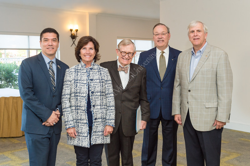 Javier Reyes, Cindi Roth, University President Gordon Gee, Marty Becker, and Greg Burton gather together after the announcement of Encova's donation for the construction of Reynolds Halls. The donation is the first to be made by a corporation - announced at the Hilton Garden Inn on September 13, 2019. (WVU Photo/Hunter Tankersley)