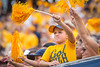 A young WVU Football fan supports his team after a touchdown. WVU Football competed against NC State at Milan Puskar Stadium on September 14, 2019.