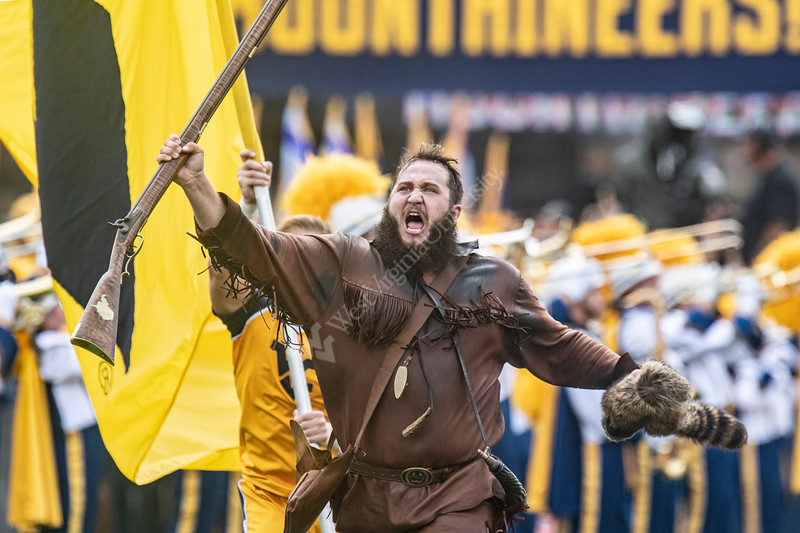WVU Mountaineer Timmy Eads leads the team onto the filed prior to the WVU Mountaineers, NC State Wolfpack game at Mountaineer Field September 14th, 2019.  (WVU Photo/Brian Persinger)