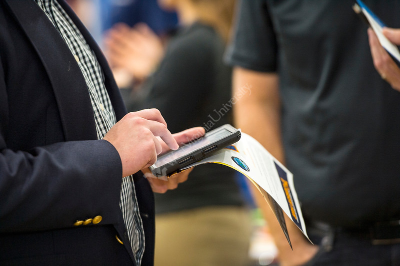 Student fills in information on an iPad at the Chambers College Career Fair on September 11, 2019 at the Student Rec Center. (Photo/Parker Sheppard)