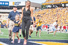 Meg Bulger walks off the field after being recoginzed during the game versus  the NC State Wolfpack at Mountaineer Field September 14th, 2019.  (WVU Photo/Brian Persinger)