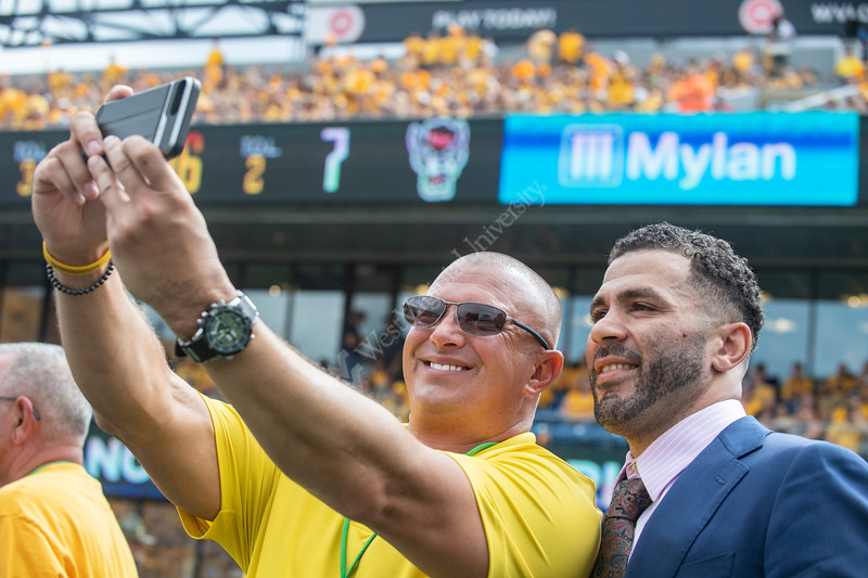 Former triple NCAA National Wrestling Champion Greg Jones poses for a selfie after being recognized on Mountaineer field during the game against the NC State Wolfpack September 14th, 2019.  (WVU Photo/Brian Persinger)